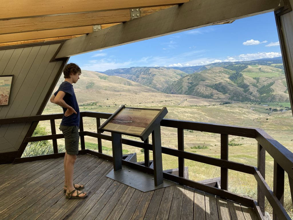 child looking at informational sign at white bird battlefield overlook
