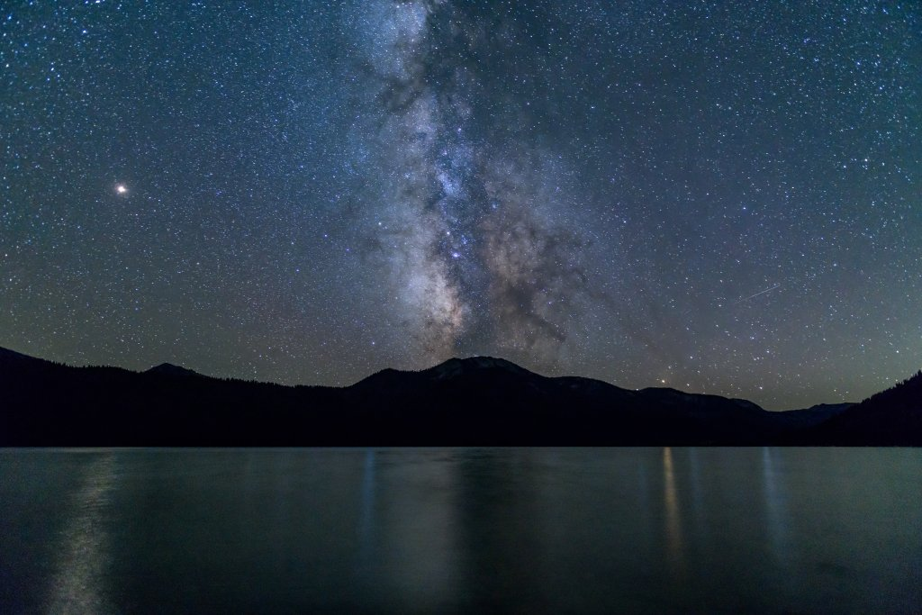 A starry night of the Milky Way, Mars, Saturn and Jupiter over Alturas Lake in Idaho