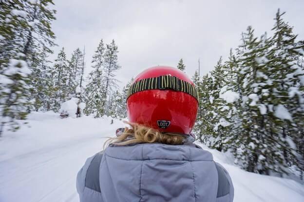 woman on snowmobile near Sun Valley