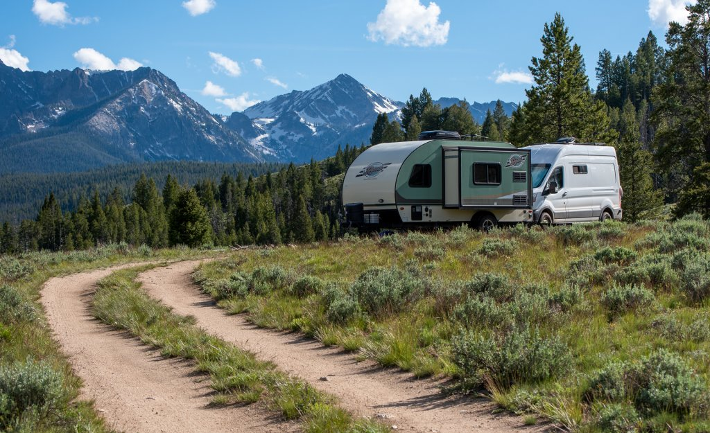travel van and camper with a mountain backdrop