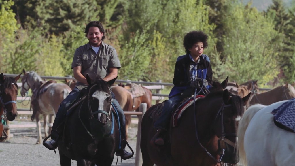 A man and child go horseback riding at the Sun Valley Stables in Sun Valley Idaho
