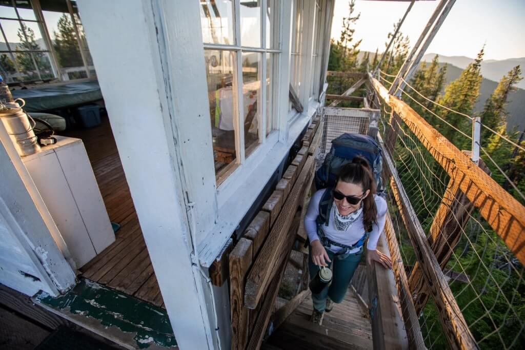 woman climbing steps of fire lookout