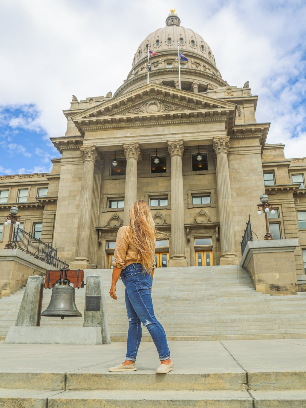 woman in front of Idaho state capitol building