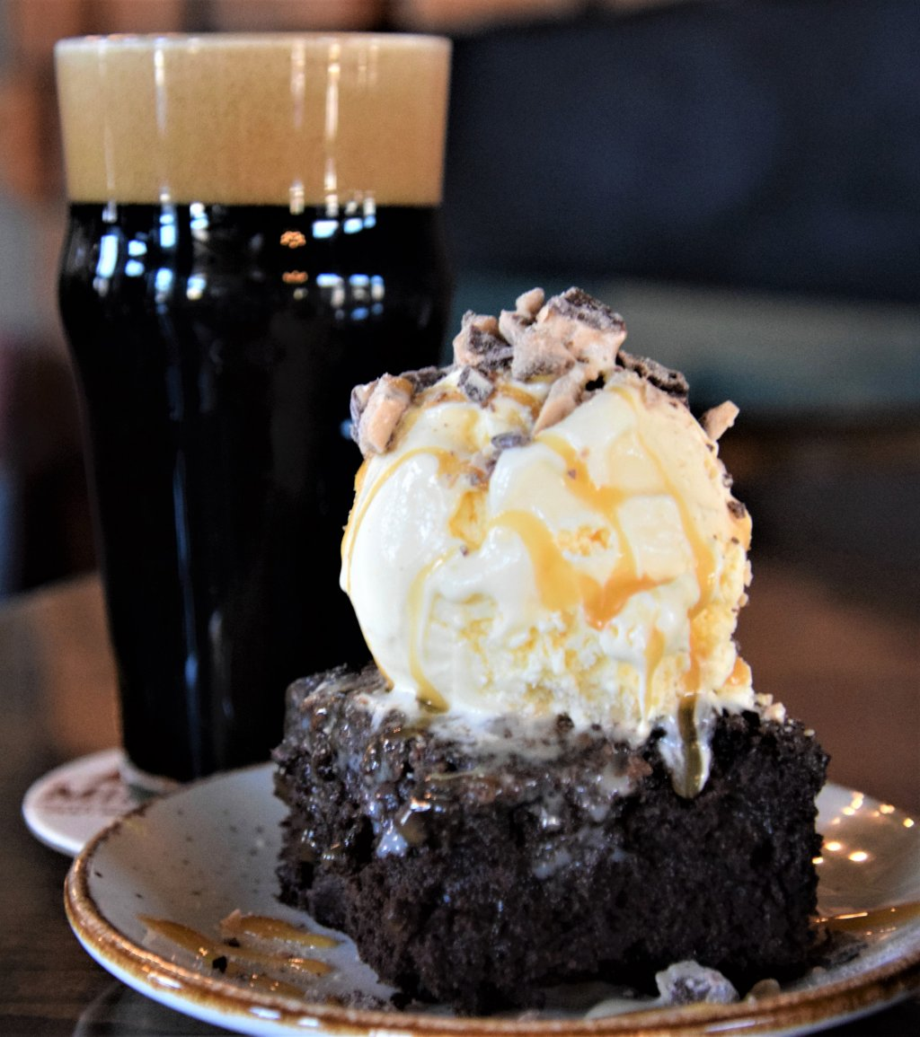 pint of beer with chocolate caramel cake