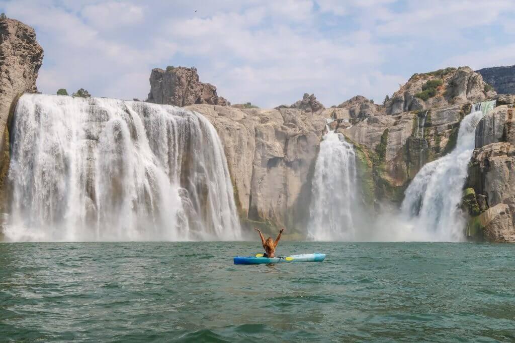 woman in kayak at base of shoshone falls