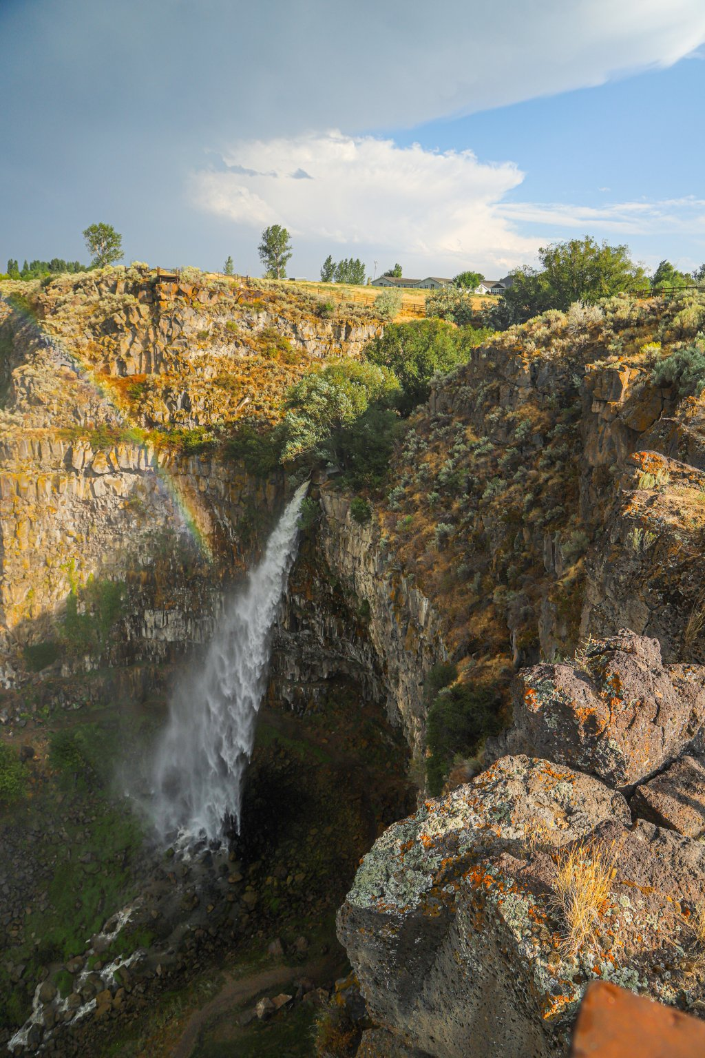 view of waterfall from edge above