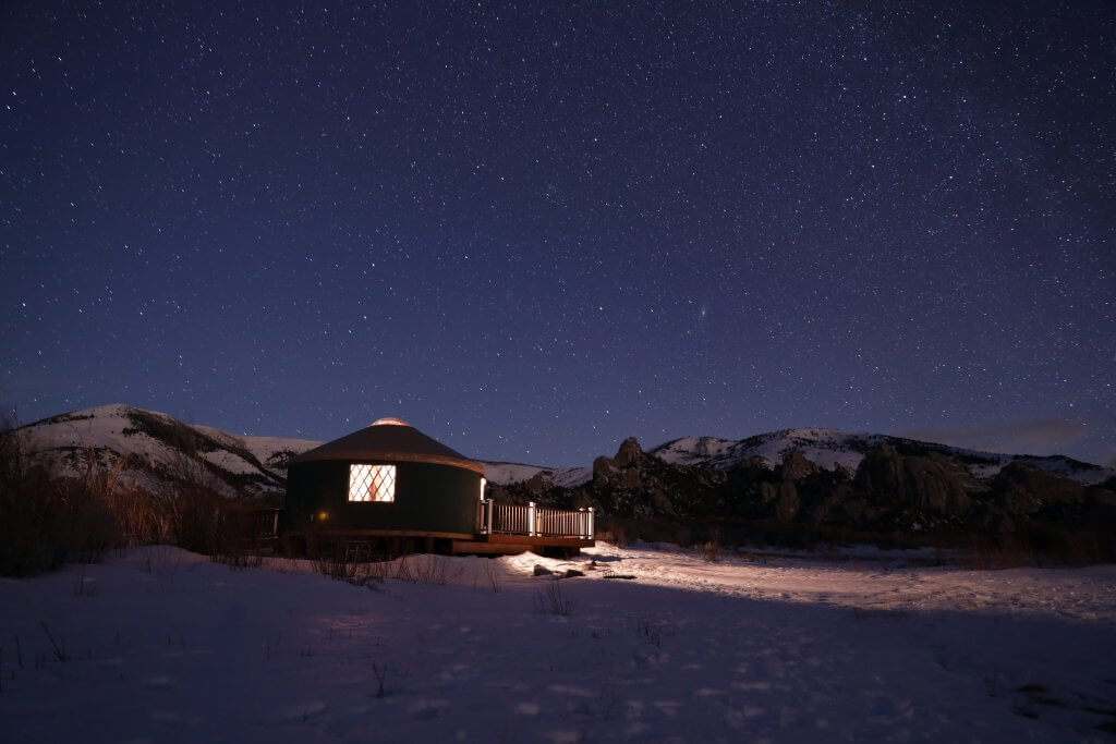 exterior of yurt at night with night sky