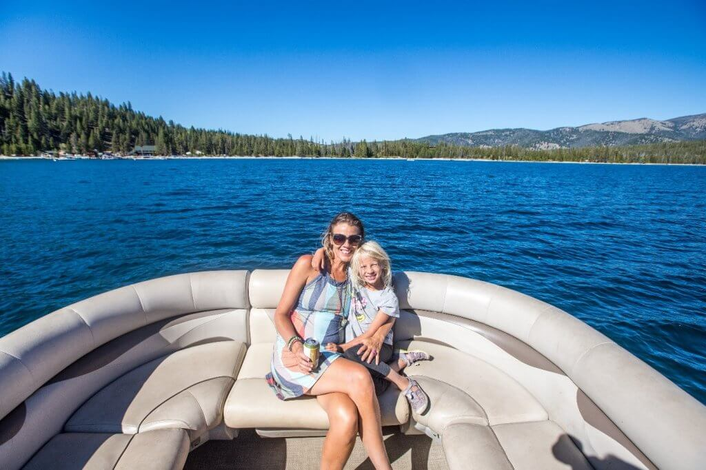 mom and daughter sitting in boat