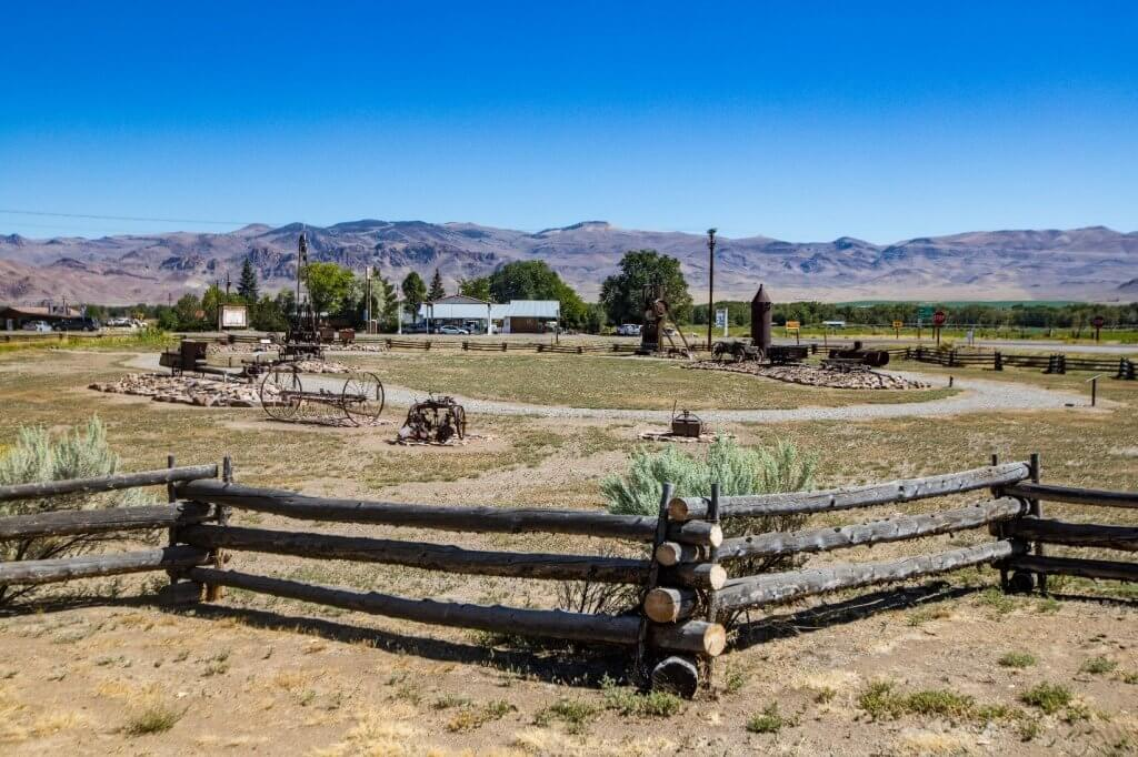 wood fence with interpretive exhibits in background