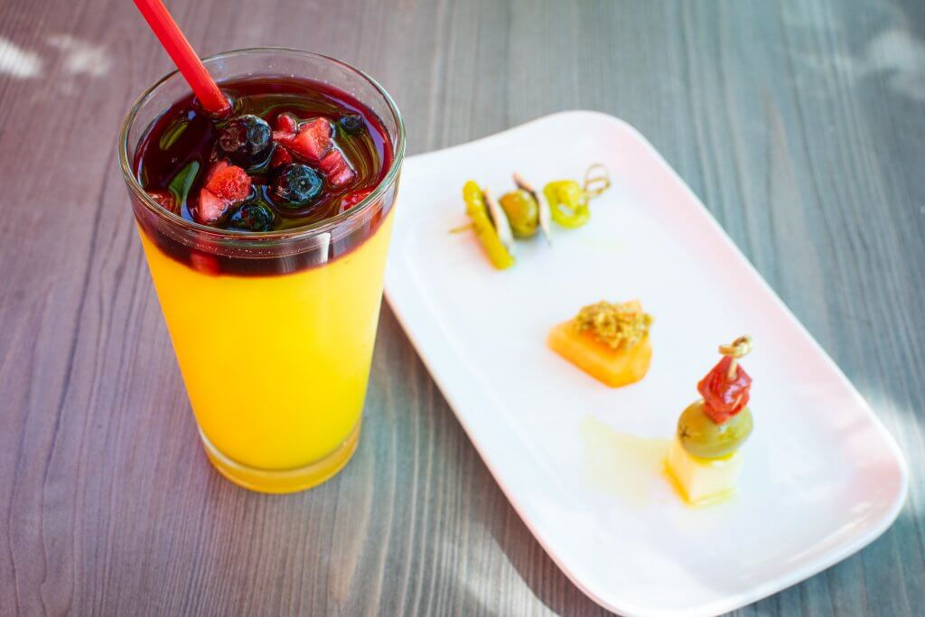 cup of frozen sangria and pintxos