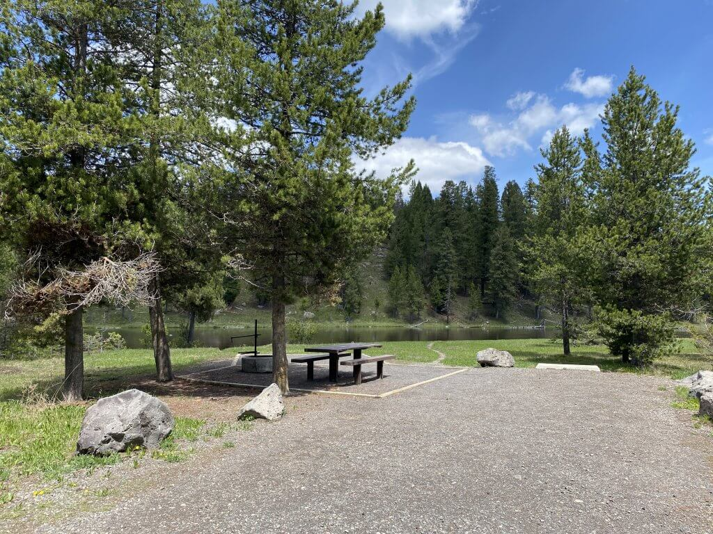 picnic table with river view at developed camp site