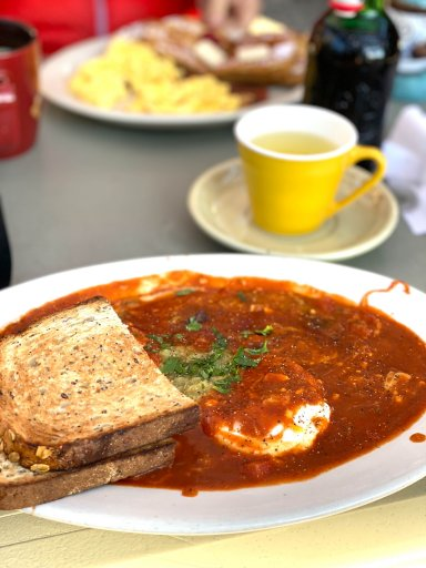 plate of eggs with toast and coffee