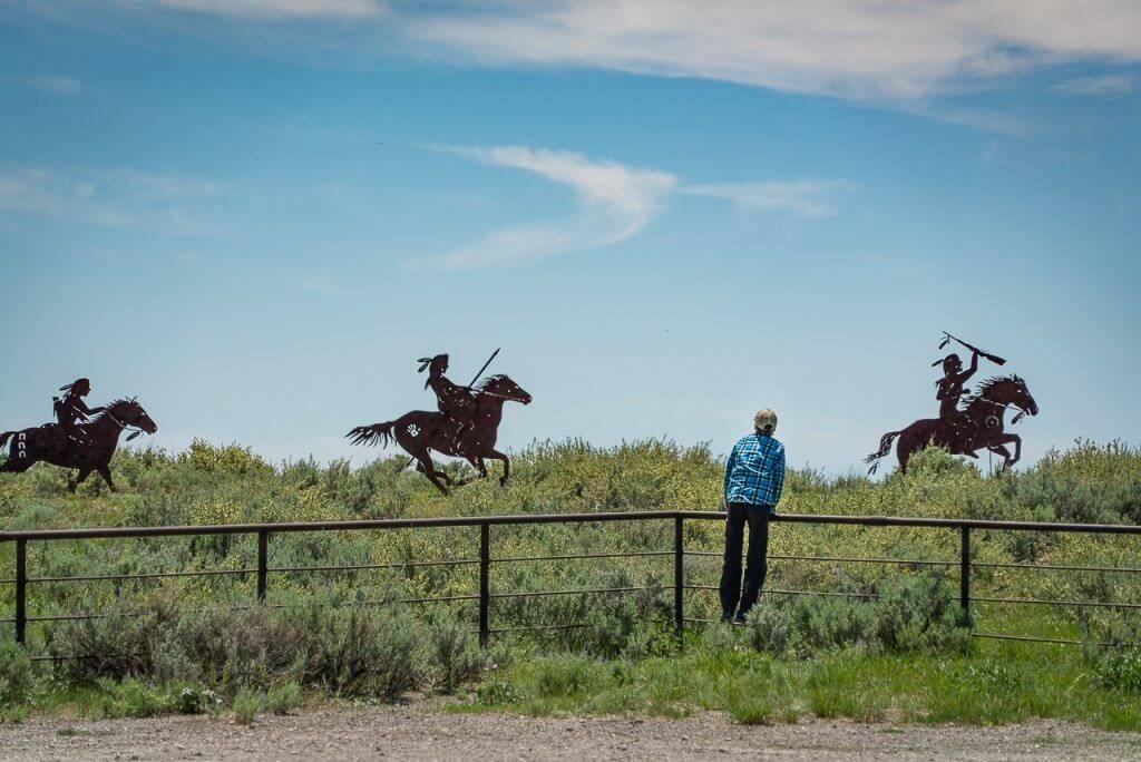 person looking at commemorative art at camas meadows