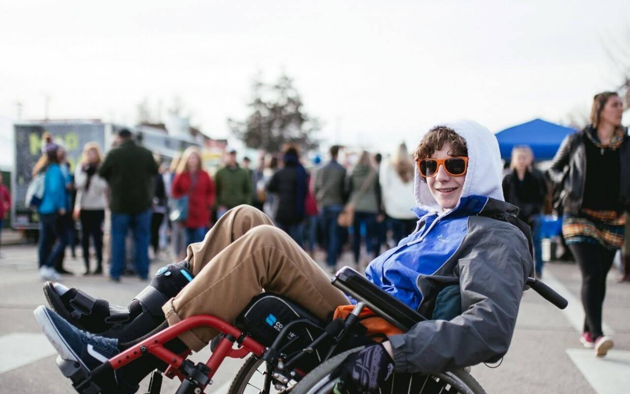 man in wheelchair doing wheelie