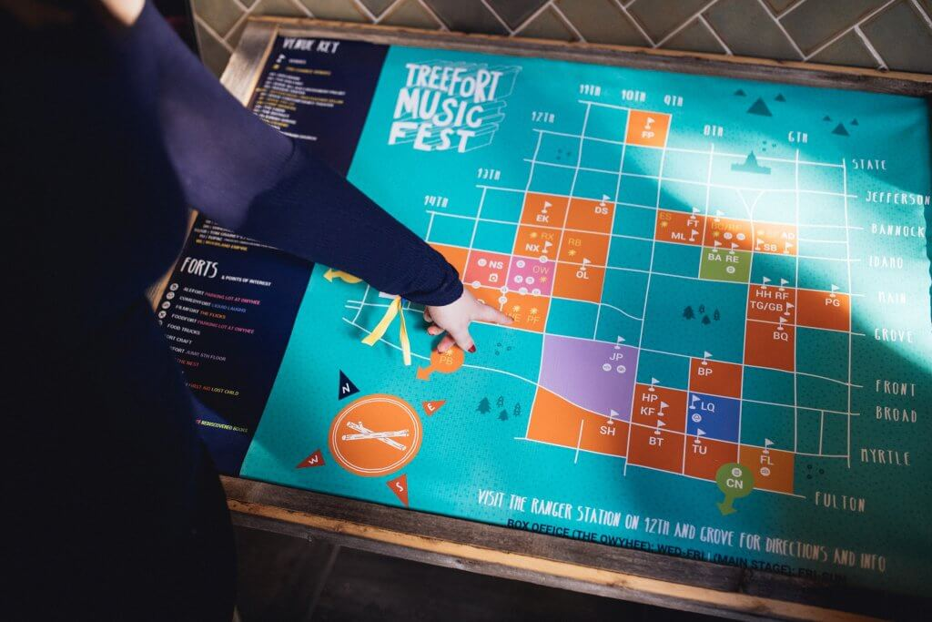woman pointing at treefort map