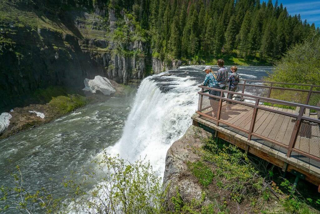 three people at waterfall overlook